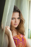 Pretty woman near window Stock Image
