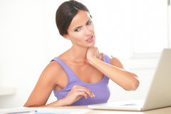 Pretty woman with neck pain working at home Stock Images
