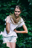 Pretty woman with necklace on nature Royalty Free Stock Photo
