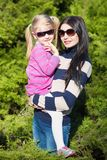 Pretty woman with nice little girl stock image