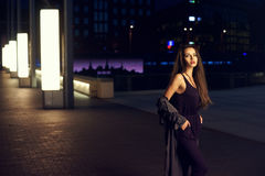 Pretty woman in night city Stock Images