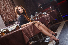 Pretty woman in nightclub Royalty Free Stock Image