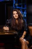 Pretty woman in nightclub Stock Photography