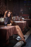 Pretty woman in nightclub Stock Images