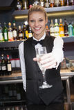 Pretty woman offering flute of champagne Royalty Free Stock Photography