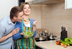 Pretty woman offers her husband to taste salad Stock Photography