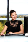 Pretty woman in the office Royalty Free Stock Photos