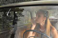 Pretty woman in old car Royalty Free Stock Photography