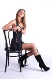 Pretty woman on old chair Royalty Free Stock Photography