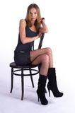 Pretty woman on old chair Stock Images