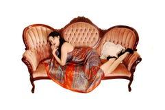 Pretty Woman On Sofa. Royalty Free Stock Photos