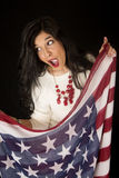 Pretty woman with an open mouth expression holding American flag Stock Images