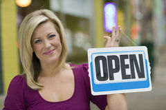 Pretty woman with open sign Stock Images