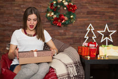 Pretty woman opening Christmas presents Stock Images