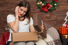 Pretty woman opening Christmas presents Stock Image