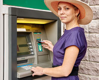 Pretty woman operates ATM Royalty Free Stock Image