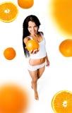 Pretty woman with orange stock image