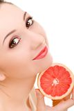 Pretty woman with orange Stock Image