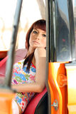 Pretty woman in orange car Royalty Free Stock Photography