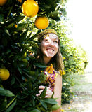 Pretty woman in orange grove smiling Royalty Free Stock Images