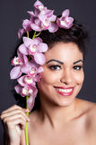 Pretty Woman with Orchid Flower Stock Photo