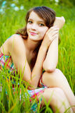 Pretty woman outdoor. Pretty young woman outdoor in the grass in summertime stock images