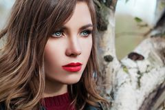 Pretty woman outdoor, beautiful female face royalty free stock photography