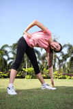 Pretty woman outdoors exercise Stock Images