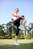Pretty woman outdoors exercise. At park with smile Stock Images