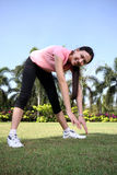 Pretty woman outdoors exercise at park. With smile Stock Photography