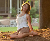 Pretty Woman Outdoors at Sunset royalty free stock image