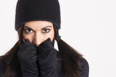 Pretty Woman Outlaw in Black Stealth Outfit Black Gloves Cap Stock Photography