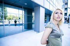 Pretty woman outside an office building Royalty Free Stock Photos