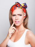 Pretty woman with painful face expression Royalty Free Stock Photography