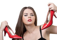 Pretty woman with a pair of red shoes in her hands Royalty Free Stock Image