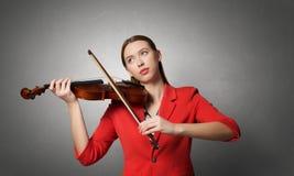 Pretty woman paly violin . Mixed media Royalty Free Stock Photo