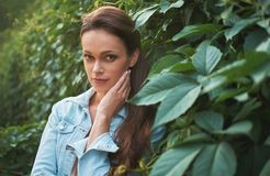 Pretty woman in the park stock images