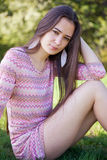 Pretty woman in the park sitting on grass Royalty Free Stock Photo