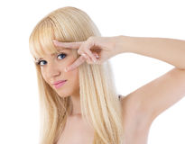 Pretty woman peering at you through her fingers Stock Images