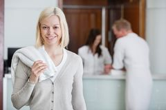 Pretty woman with people in background at spa Royalty Free Stock Photography