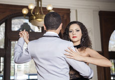 Pretty Woman Performing Tango With Man In Restaurant Stock Images