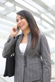 Pretty Woman on Phone at Office Royalty Free Stock Photos