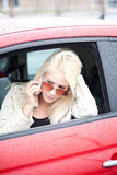 Pretty Woman On Phone In Red Car Stock Photos