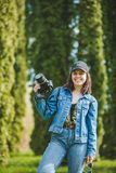 Pretty woman photographer holding professional camera royalty free stock image