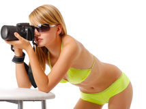 Pretty woman photographing with camera Royalty Free Stock Photography