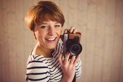 Pretty woman photographing with camera Royalty Free Stock Photo