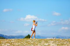 Pretty woman photographing with tablet in mountains Royalty Free Stock Images