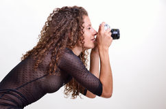 Pretty woman photographing Royalty Free Stock Images