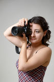 Pretty woman photographing Stock Photography