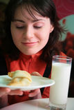 Pretty woman with pie and glass Royalty Free Stock Photos